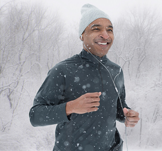 Man jogging with snow falling