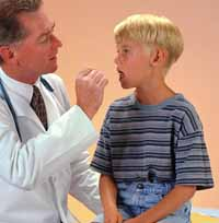 Picture of a doctor examining a young boy